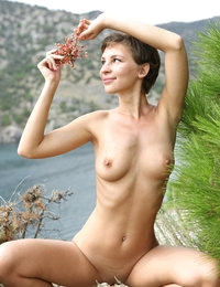 Beautiful girl Cecelia posing nude on the seaside