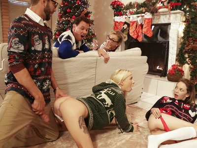 Logan Long can't stay away from the presents under the tree, and neither can his stepsister Angel Smalls and their adopted sister Kenzie Reeves. They find a gift to their mom from Santa, and discover it's a vibrator before their parents shoo them away. Later, Kenzie sneaks back into the living room and pulls out the vibrator. Lifting her sweater, she slides her thong aside and starts banging her bare pussy while Angel watches and masturbates. Now that the idea has been planted in Angel's head, she knows she needs to try the vibrator. She sneaks it out from under the tree and settles behind the couch to press it into her meaty twat while Kenzie keeps their parents busy. Logan finds Angel fucking herself, and slides his hard cock into her twat from behind. When Kenzie spots them, she excuses herself from the conversation to join in for a sibling threesome. Soon Angel finds herself with her stepbrother's cock inside her and her face planted in her adopted sister's cooch.The trio switches it up so that Kenzie can have a turn getting her pussy pounded while she feasts on Angel's delectable snatch. Her big nipples are hard as rocks as Logan spoons behind her and rubs her clit to bring her off. The girls switch off one last time so Angel can once again enjoy herself in the middle of the action, and then put Kenzie on her hands and knees while Logan continues to play stud. When he gets Kenzie off, Logan can't hold back from filling her with a creampie of cum.