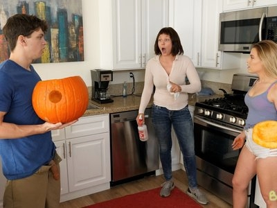 Alex D. carves a hole in a pumpkin for Halloween while his mother cleans the kitchen. He leaves the guts in the pumpkin and puts his dick in it before offering it to his stepsister Aubrey Sinclair. Alex's stunt gets them both grounded. Alex convinces Aubrey that they can get each other off and have some fun while they're grounded by stroking her twat through her shorts.Once Alex has gotten Aubrey too horny to stop, he peels off her panties and drops to his knees so he can finger and lick her hairy snatch. Then Aubrey relieves them both of their clothes so she can stroke his dick to total hardness then slide down on top of him. Once she's totally full of Alex's stiffie she rides him with long strokes of her hips and tries to contain her moans when he rolls her onto her back to get a better angle to bang her greedy fuck hole.The two have to be careful to dodge Alex's mom, so when they hear her coming they quickly hide behind the couch. Aubrey isn't willing to stop giving Alex a BJ or letting him pound her cock hungry twat, so he gives his mom any excuse he can to make her leave. When she once again has Alex's full attention, he anchors his hands on her hips and keeps stroking her snatch until she can't keep from cumming. Alex follows her over the edge, filling her pussy with a creampie of hot jizz.