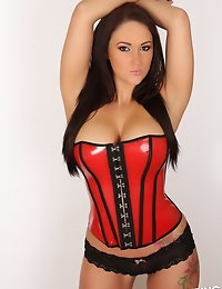 Busty Alluring Vixen Lauren Ashley teases in a super tight latex corset that barely contains her big perfect tits