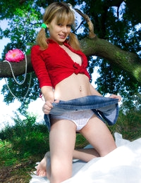 Remarkable teen with a basket of apples undressing and showing breasts and pussy outdoors.
