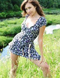 Modern girl in pure nature with a slight touch of retro outlook. She knows that the dress is actually unnecessary so she drops it as soon as possible.