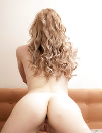 This stunning slim blonde angel takes off her hot bikini and later teases without clothes on a king sized bed.