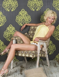 Even an armchair can be sexy and attractive when a blonde cutie likes her strips and teases in it without clothes.