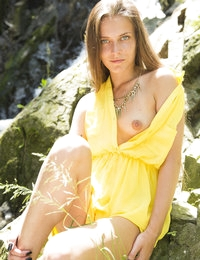 Sexy long haired babe takes her time to take her sex yellow robe that is covering her pink little pussy.