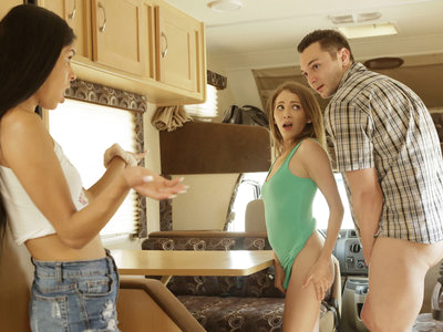 Angel Smalls waits by the roadside with her boyfriend Brad Sterling and his stepsister Katya Rodriguez as they embark on a family road trip. The first stop will be dropping Angel off at her house in another city. The trio is embarrassed when Peter, Brad's dad, pulls up in an RV, but Brad and Angel make the best of it as they sneak a makeout session. Without knowing that Katya is watching, Angel lets herself get bent over the RV table so Brad can stroke and finger her meaty pussy. Then she gets down on her knees to suck Brad's cock in a deep throat BJ before turning around once again to let Brad bang her bare twat from behind. They keep it up until Angel reveals herself.The tension between the trio is unmistakable as the family road trip starts. Katya and Brad argue about whether their sex is appropriate, and Angel eventually lets Katya guide her to the other side of the table so that they can kiss and stroke each other's small boobs. The girls relocate to the bedroom to start feasting on each other's creamy fuck holes. Using her hands and mouth, Katya brings Angel off multiple times. After her third orgasm, Angel is all too happy to return the favor for her Latina lover until the parents return.Later, Katya, Brad, and Angel all find themselves in bed together. Angel is napping, which gives Brad all the space he needs to pull his sister's thong aside and finger bang her while licking her hard nipples. It's not long before Katya happily lets Brad pound into her tight twat, first as they spoon and then as she is on her hands and knees. They keep at it until Brad pulls out to cum all over Katya's smooth back. When they arrive at Angel's house, Brad walks her out and dumps her.