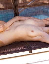 Adorable babe Beata teases her hairy twat