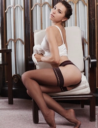 Hot chick Anita E in black stockings exposes her sexy body