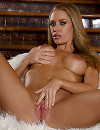 Nicole Aniston touches her curvaceous body
