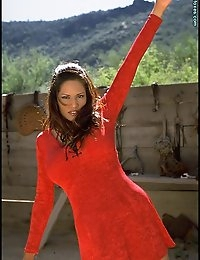 Kristine is the beautiful lady in red in this very hot set of photos taken in an Arizona ghost town. First she tempts as she strips out of her dress, and then she really pleases as she removes her little red g-string bikini.