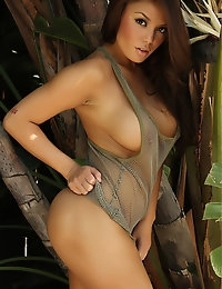 Sexy babe Justene Jaro shows off in a skimpy mesh tank top outdoors