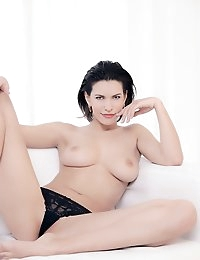 """This week's exclusive photo series features the debut set of the sensuous and seductive Nadia P. This is one classy gal, and she knows it. And so do we. : ) Sexy from top to bottom, Nadia is all woman and has no problem showing it off. In fact, she's eager to do so - which is one of the things we love about her. She's not afraid to express herself and let what has been given to her be seen in all it's glory. we couldn't wish for anything more. : ) Here's what some of our members had to say about this voluptuous beauty;""""Very nice pics. such a pretty woman in great poses showing her full womanhood.""""""""Wow, what a gorgeous lady. Love the pose with the knickers on with all the expectant fun of what is to come when that lovely pussy comes into view. Very sexy pose.""""""""I love a photo like this - hot girl, panties part-way down. awesome.""""""""A perfect model!!!""""""""Nadia is really most attractive!! 5 stars*****""""""""Fantastic! Nadia is pure and beautiful from the tip of her perfect toes to the top of her gorgeous, classy face.""""""""Nadia is a lovely addition to Femjoy. Love those curves and that porcelain skin tone.""""""""Bottom's up!""""""""Very pretty, lovely form and skin nice setting too. Hope to see more of her in the future. A true woman!""""Well said dear members. We agree 100% and are so happy to be able to bring this true beauty to you. We hope to bring you a lot more of her, but until then, please enjoy this debut set from this gorgeous gal - and stay tuned for more! Enjoy!"""