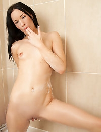 Horny coed soaks her big nipples and tight snatch with a shower head