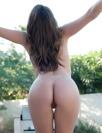 Devine One Tori Black shows off her perfect round ass outdoors completely in the nude