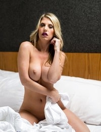Kyra Marie posing naked in white sheets