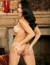 Jasmine Caro has a luscious body and enjoys showing off her massive breasts.