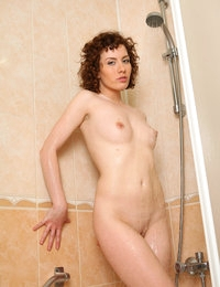 Renata get wet showering and presses small boobs up against the glass
