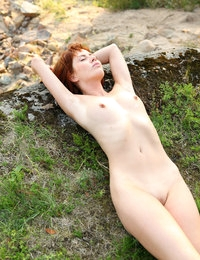 Small chested Renata on top of a hill nude communicating with nature