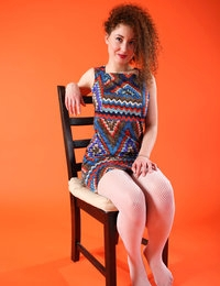 Daisy in zigzag dress and torn fishnet stockings with her cunt exposed