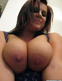 Chubby girlfriend takes selfshot pictures of her really huge plump tits in the mirror
