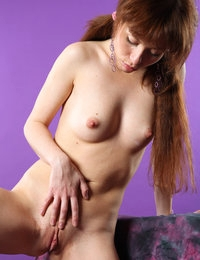 Petite Renata with small tits rubs her cutely shaved cunt on purple sheets