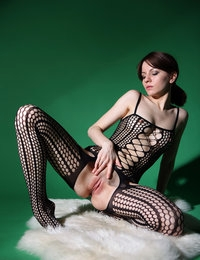 Hot lingerie babe undulates her slim forms and poses her shaved pussy