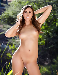 Anastasia Black lays naked by the lake showing her pussy