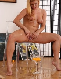 Pretty blonde toys her piss soaked pussy