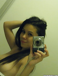 Cute exotic girlfriend takes selfshot pictures for her boyfriend of her perky tits in the bathroom