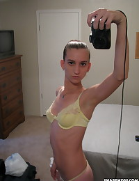 Skinny girlfriend takes selfshot pictures in the mirror of her perky tits in a yellow lace bra