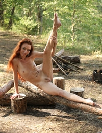 Skinny redhead Kesy boasts of her tight ass and trimmed pussy