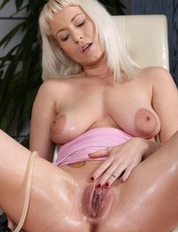 Pretty blonde fucks her pussy and ass with toys