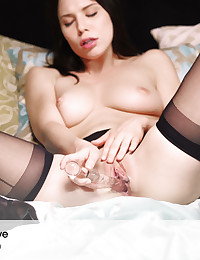X-Art Girl Aidra has a great body, a beautiful face (those cute dimples!) and an intensely sensual quality that the camera adores. It was her idea to dress for bed in a garter, sheer stockings and high heels. Add a translucent dildo and let nature take its course.