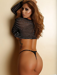 Stunning Alluring Vixen babe Theresa Erika shows off her tight body in a skimpy crop top