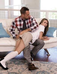 Johnny Castle spies his stepdaughter Anya Olsen checking out dick pics on her cell phone, so he punishes her by leaning her over his knee and lifting up her uniform skirt to spank her. Anya finally gets him to stop spanking her by saying that she'll look at his dick instead of random ones on the Internet. When Jonny agrees, Anya gets down on her knees and whips his cock out.The next thing Johnny knows, Anya has wrapped her puffy lips around his stiffie and has started sucking. His weak protests soon die away as he allows her to pleasure him with her sweet soft mouth. When Anya pushes her thong to the side and slides down on Johnny's dick, he's too into having his stepdaughter dominating him to say no!Now that Anya has started getting off with Johnny's dick, she's not about to stop until she's totally satisfied. She rides him with fast movements of her hips until he finally flips her onto her back to have the chance to fuck her right. As soon as she has finished, she drops back onto her knees to suck her stepdad off until he gives her the facial that she craves to finish off her exploratory lovemaking session.