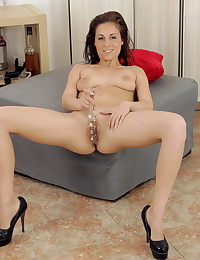 Hot brunette teases her pussy with sex toys photo #10