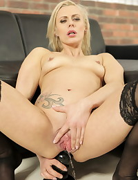 Hot blonde MILF uses massive dildos on her pussy photo #13