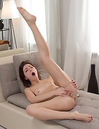 Sexy Leona shoves a toy up her tight little ass photo #13