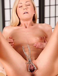 Cute blonde stretches her pussy wide with speculum photo #13