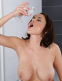 Big boobed brunette pisses into a pussy pump photo #15