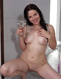 Dark haired babe pisses into a wine glass photo #15