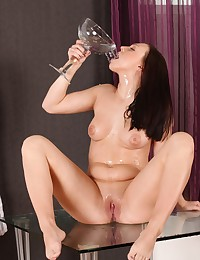 Dark haired babe toys her piss soaked pussy photo #15