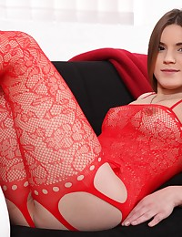 Pretty brunette shows her pussy in bodystocking photo #2