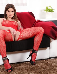 Pretty brunette shows her pussy in bodystocking photo #5