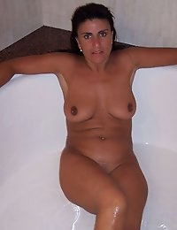 Wife Bucket - Real amateur wives and MILFs! Swingers too! photo #2
